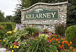 Photo of Welcome to Killarney plaque with flowers